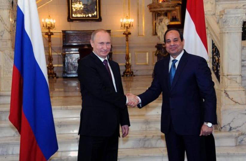Russia's President Vladimir Putin (L) shakes hands with Egypt's President Abdel Fattah al-Sisi in Cairo (photo credit: REUTERS)
