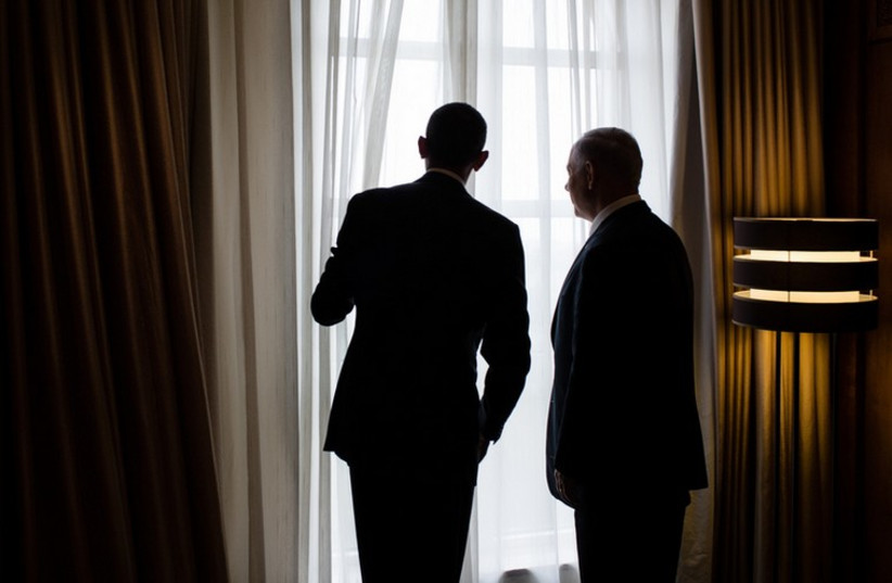 US President Barack Obama and Prime Minister Benjamin Netanyahu look out a window (photo credit: OFFICIAL WHITE HOUSE PHOTO BY PETE SOUZA)