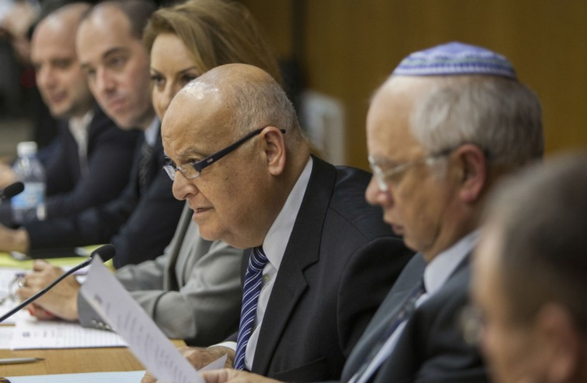 Supreme Court Judge Salim Joubran (center), head of the Central Elections Committee, accepts a party list, January 28. (photo credit: Courtesy)