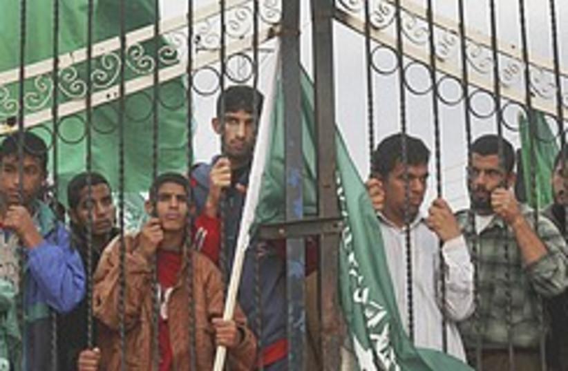 gazans behind gate  248.88 (photo credit: AP)