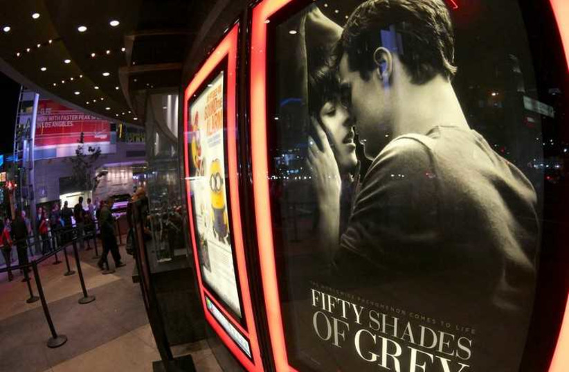 """A film poster for """"Fifty Shades of Grey"""" is pictured at Regal Theater in Los Angeles (photo credit: REUTERS)"""