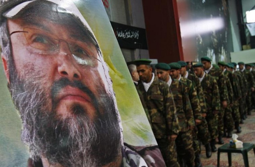 Hezbollah operatives pay their respects during the funeral of assassinated commander Imad Mughniyeh in Beirut's suburbs  (photo credit: REUTERS)
