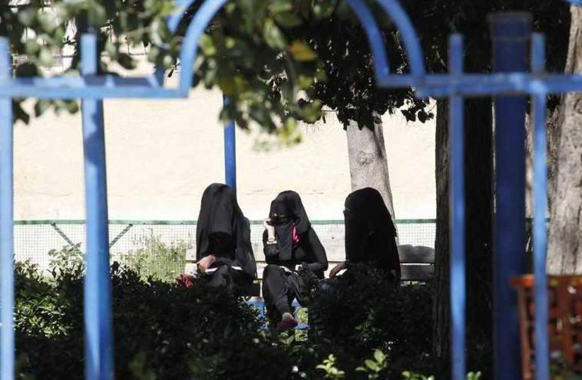 Veiled women in the northern province of Raqqa, Iraq (photo credit: REUTERS)