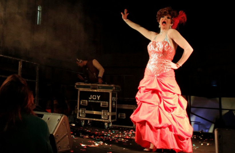 A drag queen performs on stage before the Drag Race in central Jerusalem, February 16, 2015. (photo credit: REUTERS)