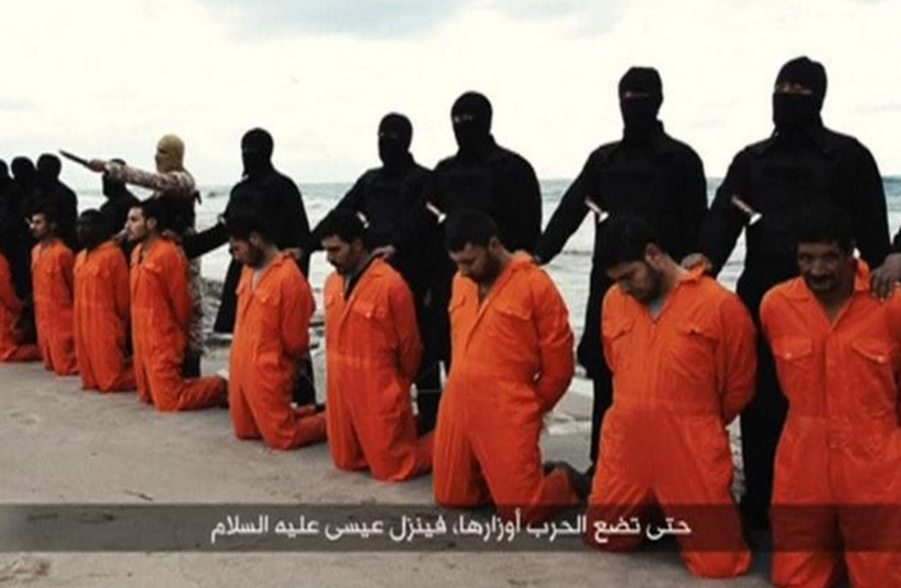 Egyptian Christians in orange jumpsuits just before their execution by ISIS henchmen (photo credit: REUTERS)