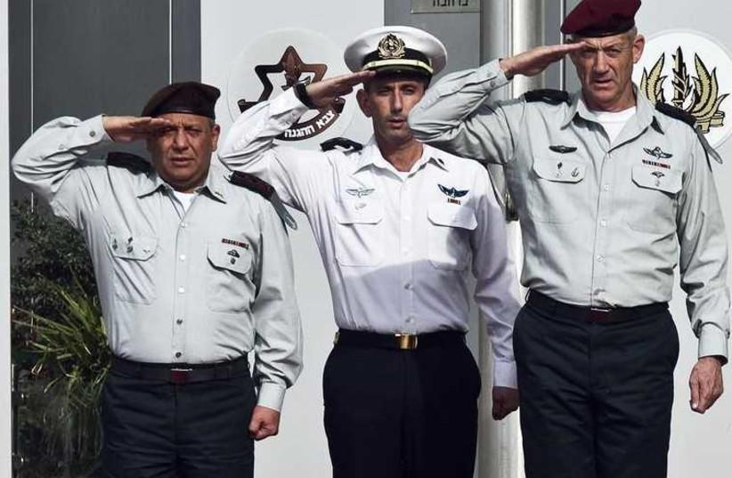 New IDF chief of staff Lieutenant-General Gadi Eizenkot (L) and outgoing chief of staff Lieutenant-General Benny Gantz (R) salute during a handover ceremony in Tel Aviv (photo credit: REUTERS)
