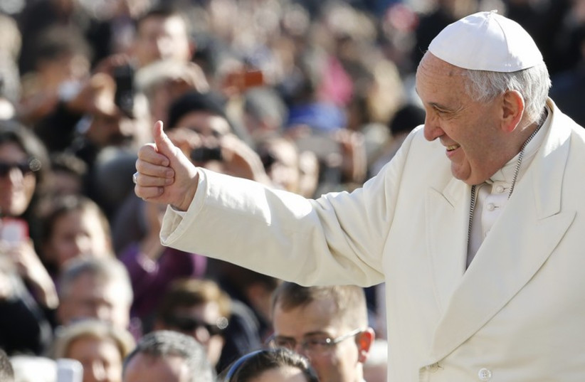 Pope Francis gives the thumb up as he arrives to lead the weekly audience in Saint Peter's Square at the Vatican. (photo credit: REUTERS)