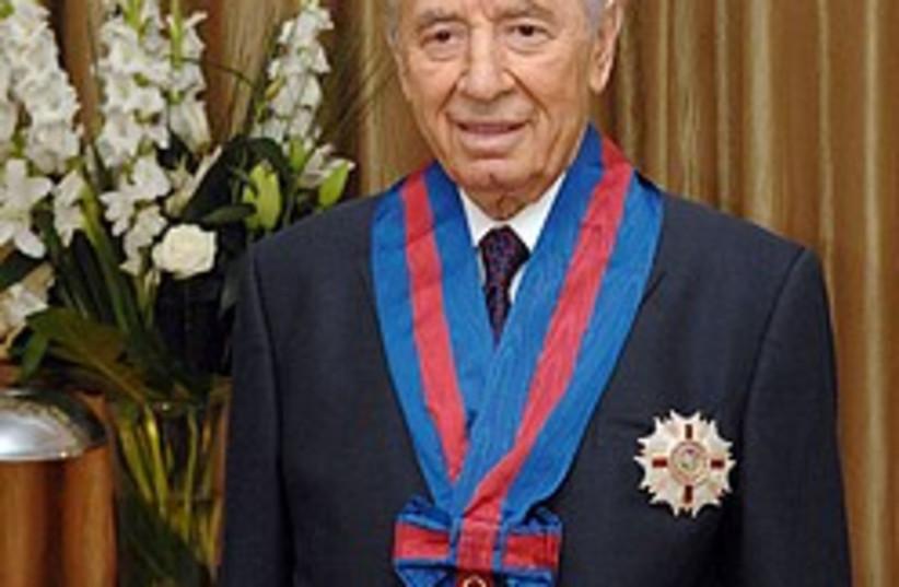 Peres knighthood 248.88 (photo credit: GPO )