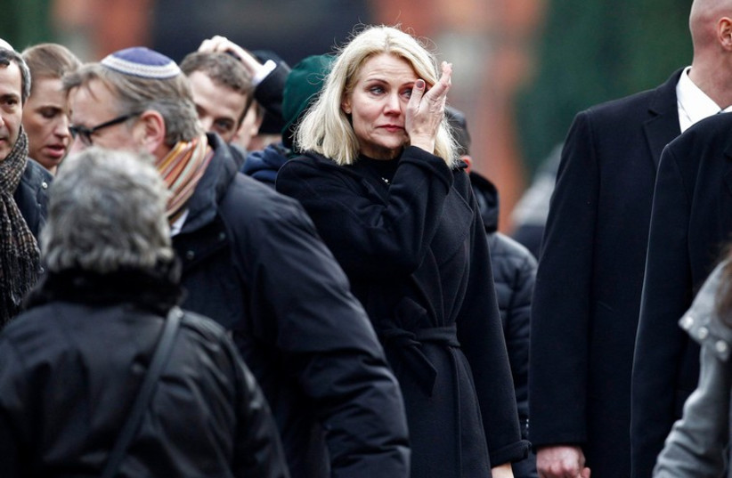 Danish Prime Minister Helle Thorning Schmidt (C) reacts after the funeral ceremony of shooting victim Dan Uzan, who died on Saturday when a gunman attacked a synagogue, in Copenhagen February 18, 2015. (photo credit: REUTERS)
