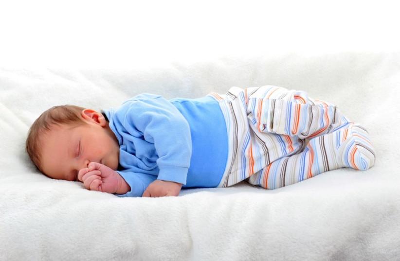 Baby boy in sleeping on bed (photo credit: ING IMAGE/ASAP)