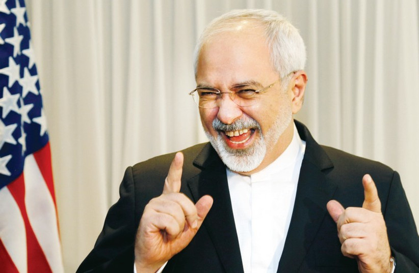 Iranian Foreign Minister Mohammad Javad Zarif talks with reporters before meeting with US Secretary of State John Kerry in Geneva in January. (photo credit: REUTERS)