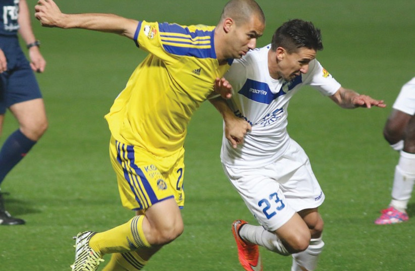 Maccabi Tel Aviv midfielder Gili Vermouth (left) will hope to improve on his mediocre debut (photo credit: ADI AVISHAI)