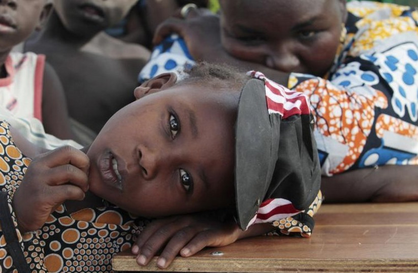 A girl displaced as a result of Boko Haram attack in the northeast region of Nigeria, rests her head on a desk at Maikohi secondary school camp for internally displaced persons (IDP) in Yola (photo credit: REUTERS)
