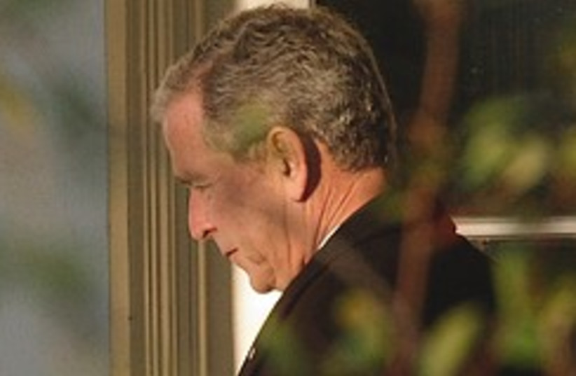 bush sad 248.88 (photo credit: AP)