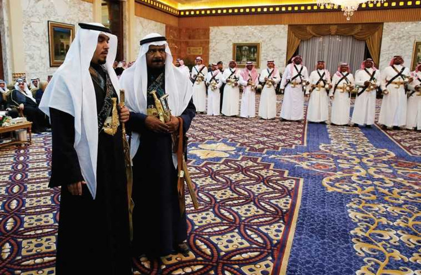 MEMBERS OF the palace staff stand in waiting during Saudi Arabia's King Salman's meeting with US President Barack Obama at Erga Palace in Riyadh in January (photo credit: REUTERS)