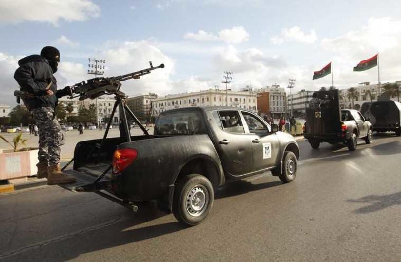 Libyan police in Tripoli (photo credit: REUTERS)