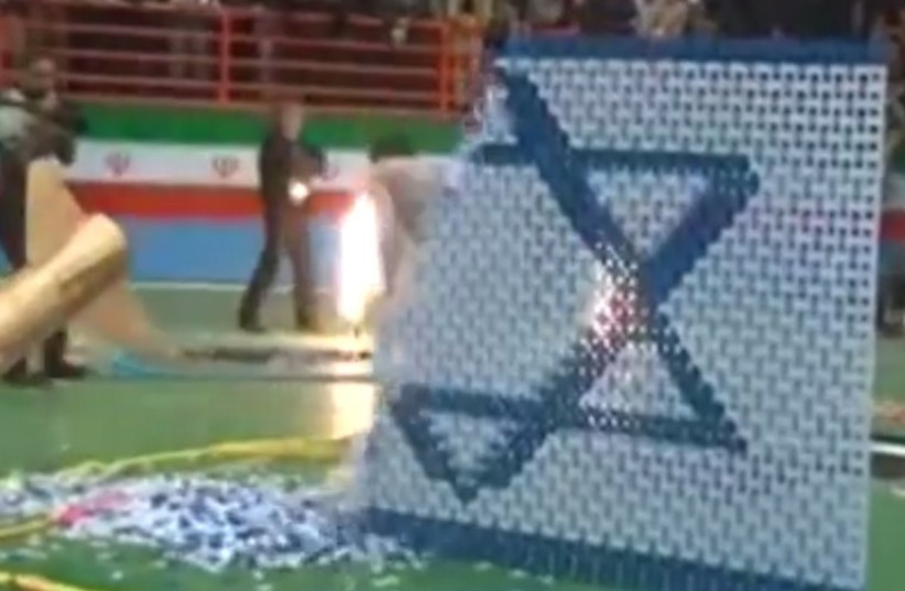 Nuclear-themed domino show in Iran culminates with missile destroying Israeli flag.. (photo credit: MEMRI)
