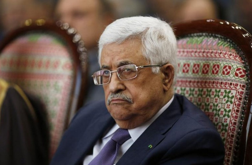 Palestinian Authority President Mahmoud Abbas attends a ceremony in Ramallah (photo credit: REUTERS)