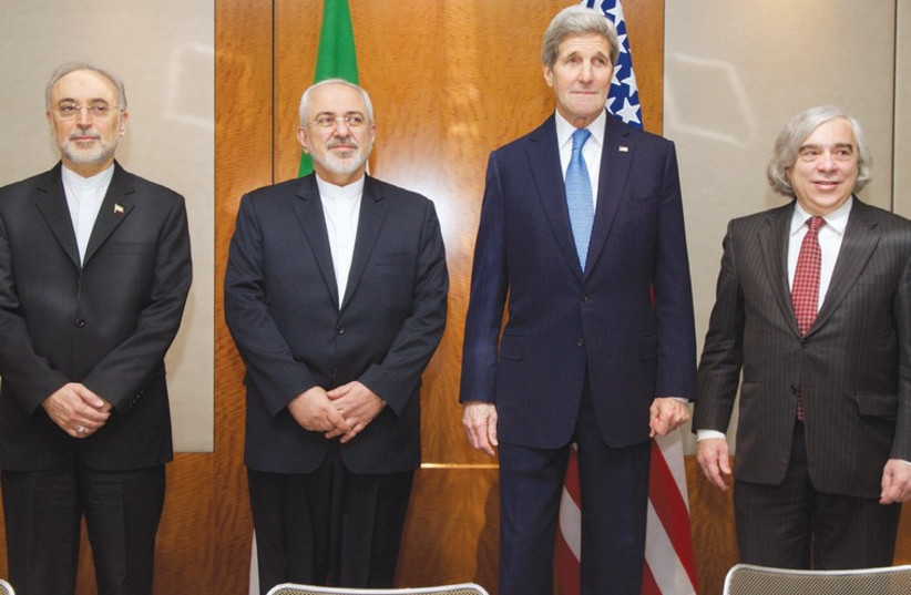 US AND IRANIAN negotiators pose yesterday in Geneva before another discussion of Iran's nuclear program (photo credit: REUTERS)