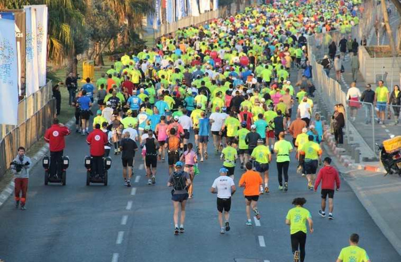 Tel Aviv Marathon participants run the race in 2014 (photo credit: MAGEN DAVID ADOM)