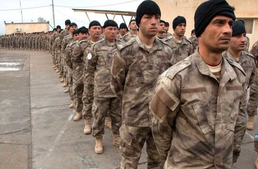 Soldiers from the Nineveh Plains Protection Units, a military organization created last year in Iraq to defend and retake Assyrian Christian land conquered by Islamic State (photo credit: JNS.ORG)