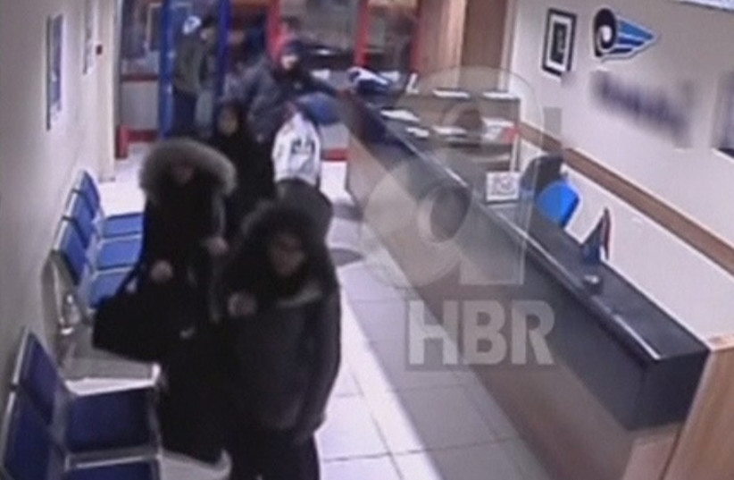 Three British schoolgirls, thought to be trying to join militant Sunni Islamist group Islamic State, boarding a bus in Istanbul's Esenler district (photo credit: screenshot)