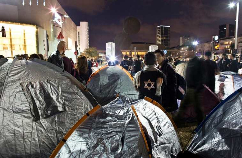 Activists stand near tents on Rothschild Boulevard in Tel Aviv March 1, 2015 (photo credit: REUTERS)