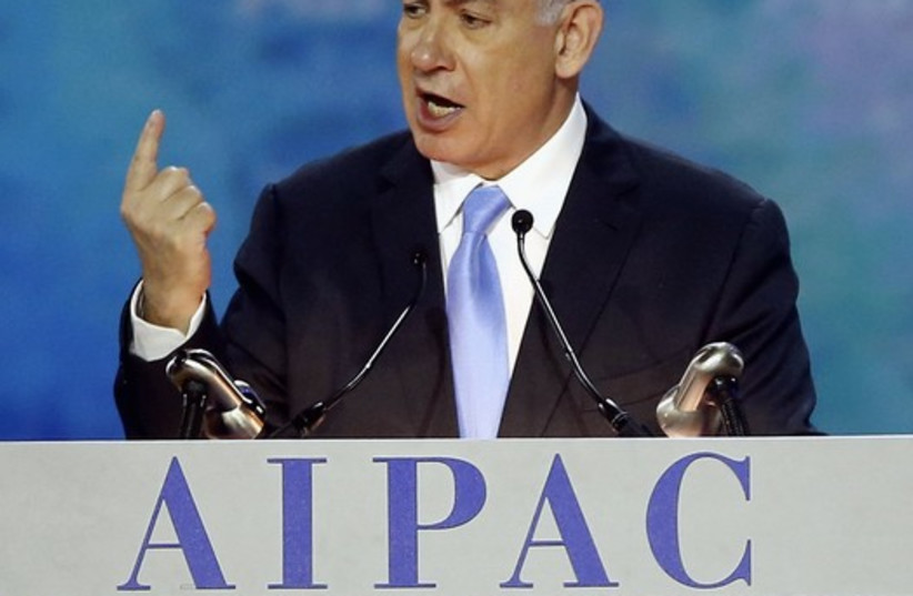 Israel's Prime Minister Benjamin Netanyahu gestures as he addresses the American Israel Public Affairs Committee (AIPAC) policy conference in Washington, (photo credit: REUTERS)