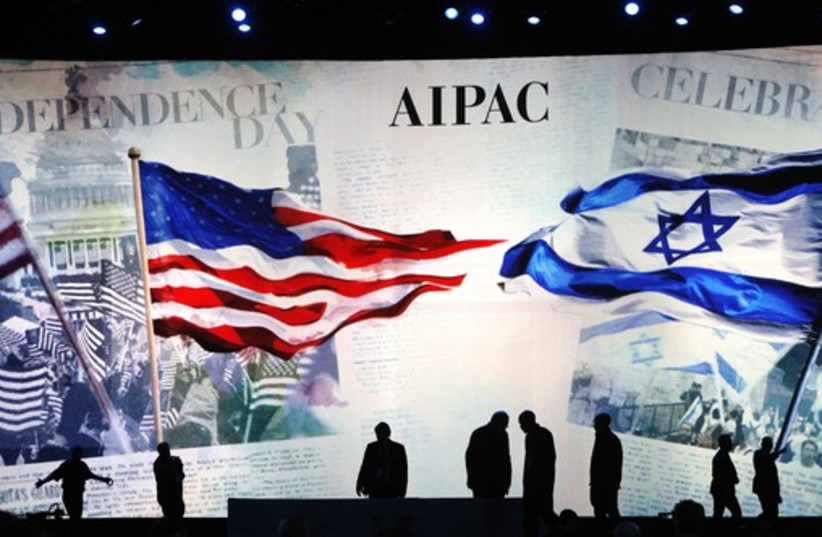 Workers set the stage at the AIPAC conference in Washington, March 2 (photo credit: REUTERS)
