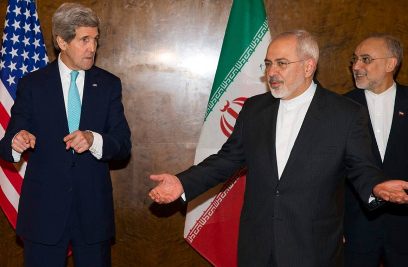 US Secretary of State John Kerry and Iran's Foreign Minister Mohammad Jawad Zarif (C) at nuclear negotiations in Montreux, Switzerland (photo credit: REUTERS)