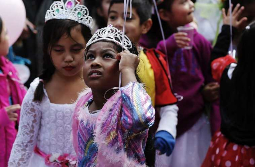Children dressed up for Purim (photo credit: REUTERS)