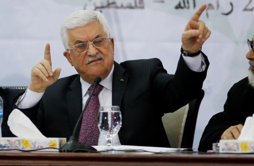 PA President Mahmoud Abbas (C)  at a meeting for the Central Council of the PLO, in Ramallah, March 4, 2015 (photo credit: REUTERS)