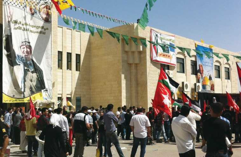 Students at Al-Quds University demonstrate during student elections in 2011. (photo credit: SETH J. FRANTZMAN)