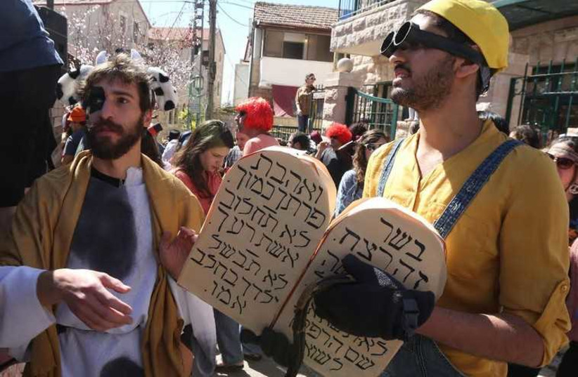 Jerusalemites revel during Purim festivities in the downtown neighborhood of Nahlaot (photo credit: MARC ISRAEL SELLEM)