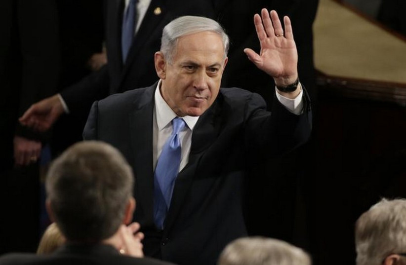 Prime Minister Benjamin Netanyahu gestures during his appearance before Congress (photo credit: REUTERS)
