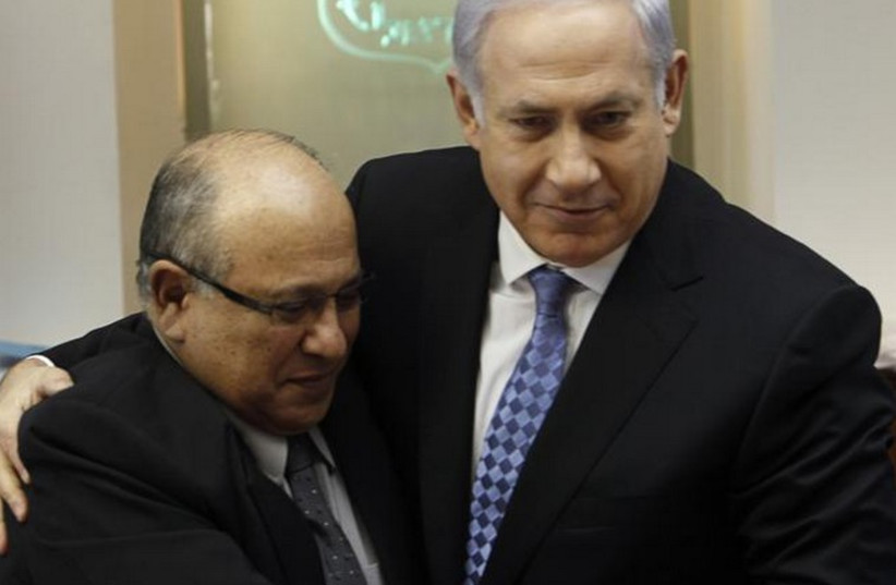 Prime Minister Benjamin Netanyahu (R) embraces former Mossad chief Meir Dagan in 2011 (photo credit: REUTERS)
