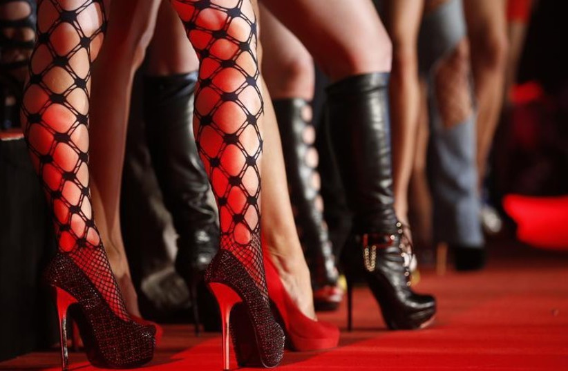 "Porn actresses line-up at the opening of the ""Venus"" erotic fair in Berlin (photo credit: REUTERS)"