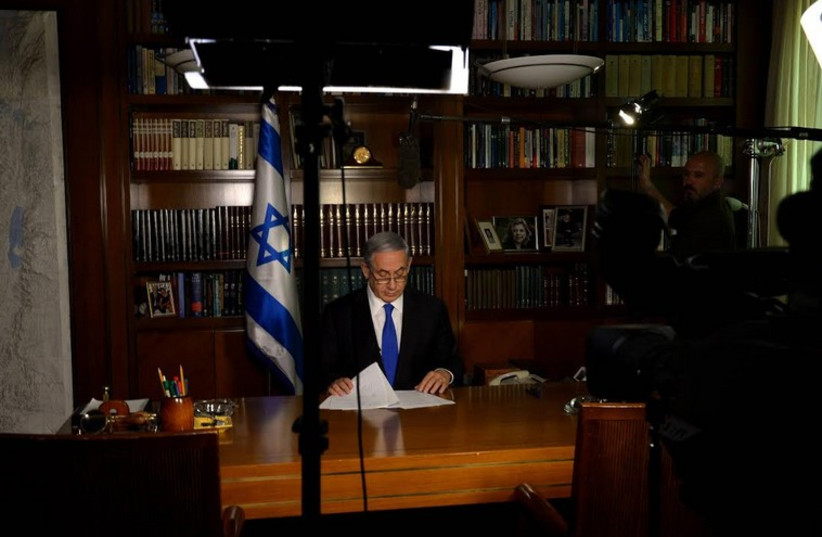 Prime Minister Benjamin Netanyahu preparing for an interview with CBS's Face the Nation (photo credit: GPO)