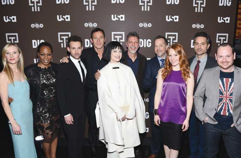 The cast of 'Dig' with executive producers Tim Kring (center) and Gideon Raff (far right) at the TV series premiere in New York (photo credit: Courtesy)