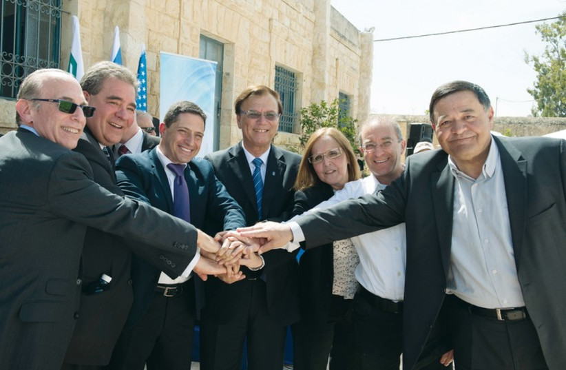 VIP guests representing residents of the Negev, BGU and JNF including Russell Robinson, CEO of the Jewish National Fund USA (second from left), Beersheba Mayor Ruvik Danilovich and KKL-JNF World Chairman Efi Stenzler celebrate the inauguration of the Lauder Employment Center, March 2015 (photo credit: NOA GRAYEVSKY)