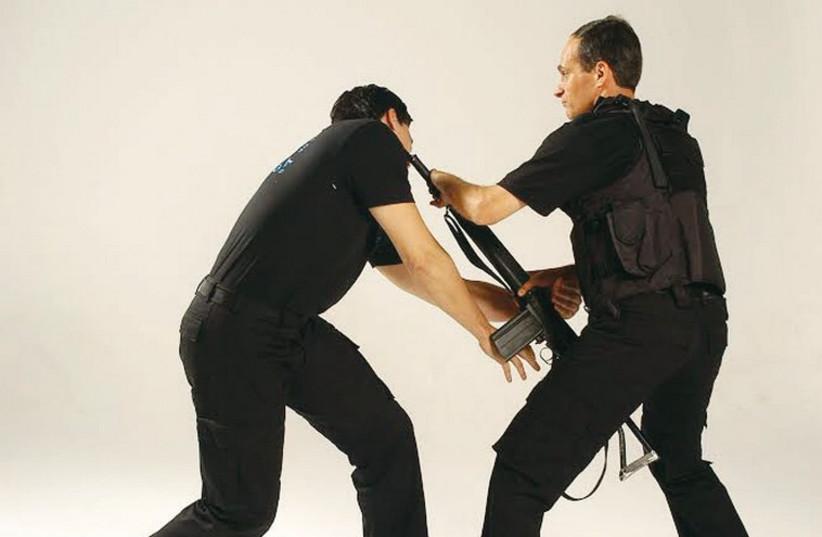 Kobi Lichtenstein (right) demonstrates how to disarm an enemy using Krav Maga. (photo credit: Courtesy)