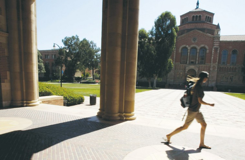 A student walks on the University of California Los Angeles campus. (photo credit: REUTERS)