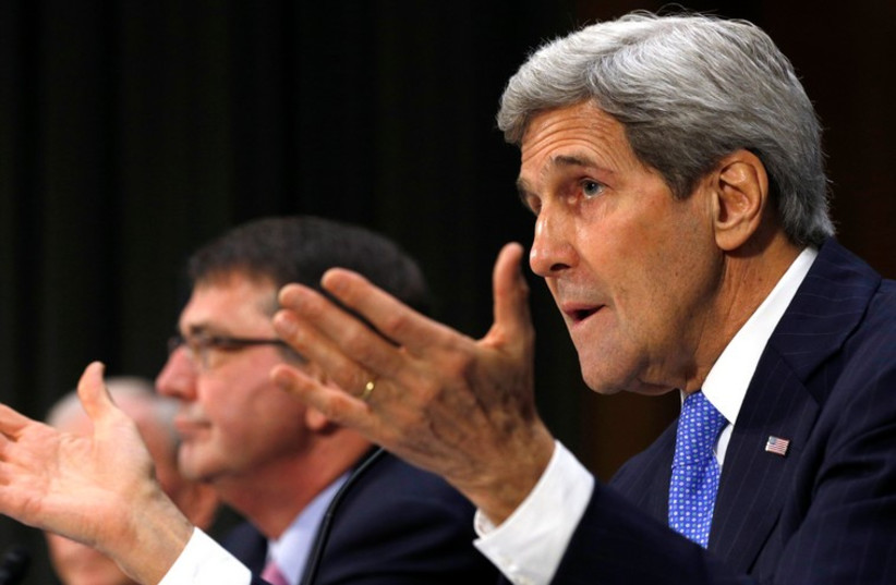 US Secretary of State John Kerry (R) speaks during a Senate Foreign Relations Committee hearing, March 11, 2015 (photo credit: REUTERS)