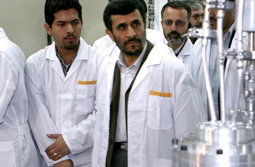 Former Iranian president Mahmoud Ahmadinejad (second left) visits the Natanz nuclear enrichment facility. (photo credit: REUTERS)