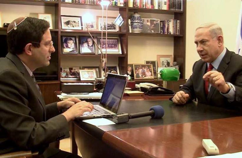 Jpost Political Correspondent Gil Hoffman interviews Prime Minister Benjamin Netanyahu (photo credit: VOICE OF ISRAEL)