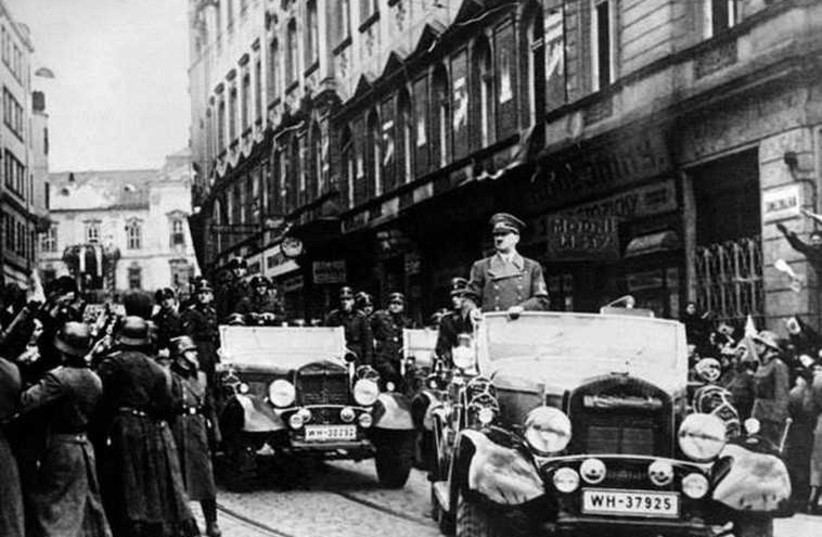 A victorious Hitler parades in just-occupied Prague: Does Buji's optimism arouse howls of derision in Tehran's halls of power?  (photo credit: Courtesy)