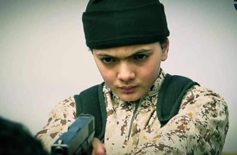 The young boy who appears in the ISIS video moments before purportedly executing 'an Israeli spy' (photo credit: screenshot)