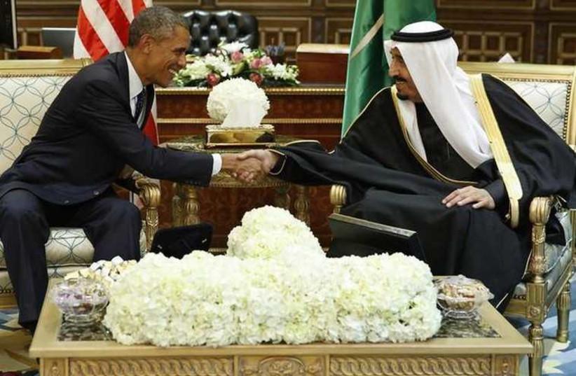 US President Barack Obama (L) shakes hands with Saudi Arabia's King Salman at the start of a bilateral meeting at Erga Palace in Riyadh (photo credit: REUTERS)