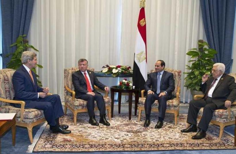 US Secretary of State John Kerry, Jordanian King Abdullah, Egyptian President Abdel Fattah al-Sisi and Palestinian President Mahmoud Abbas meet on March 13, 2015. (photo credit: REUTERS)