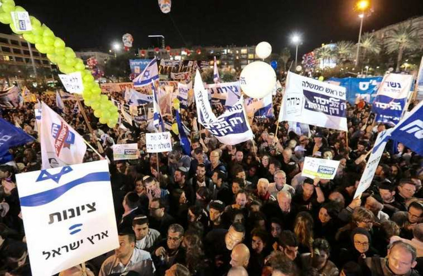 """Right-wing rally in Tel Aviv, dubbed """"United for the Land of Israel,"""" March 15, 2015 (photo credit: MARC ISRAEL SELLEM/THE JERUSALEM POST)"""